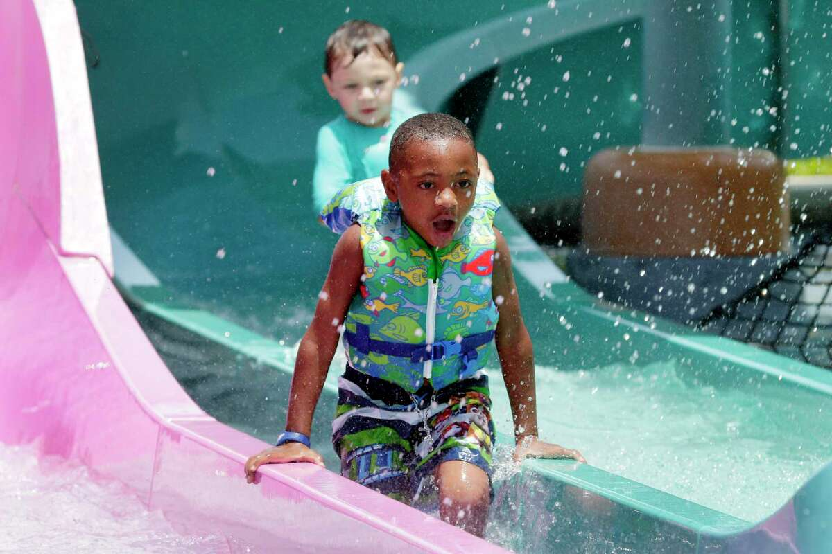 Kids swim in The Gully Washer at the Typhoon Texas waterpark.