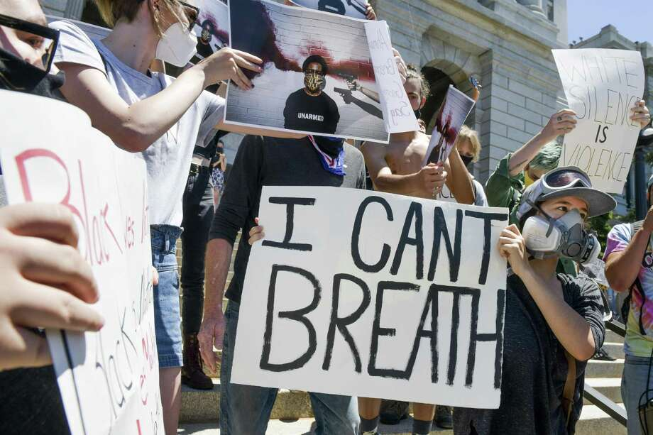 DENVER, CO - MAY 29: People gather to protest the death of George Floyd on the steps of the Colorado state capitol on May 29, 2020 in Denver, Colorado. Yesterday, protests in Denver were broken up with tear gas and pepper spray after someone fired gunshots near the capitol. (Photo by Michael Ciaglo/Getty Images) Photo: Michael Ciaglo, Stringer / Getty Images / 2020 Getty Images