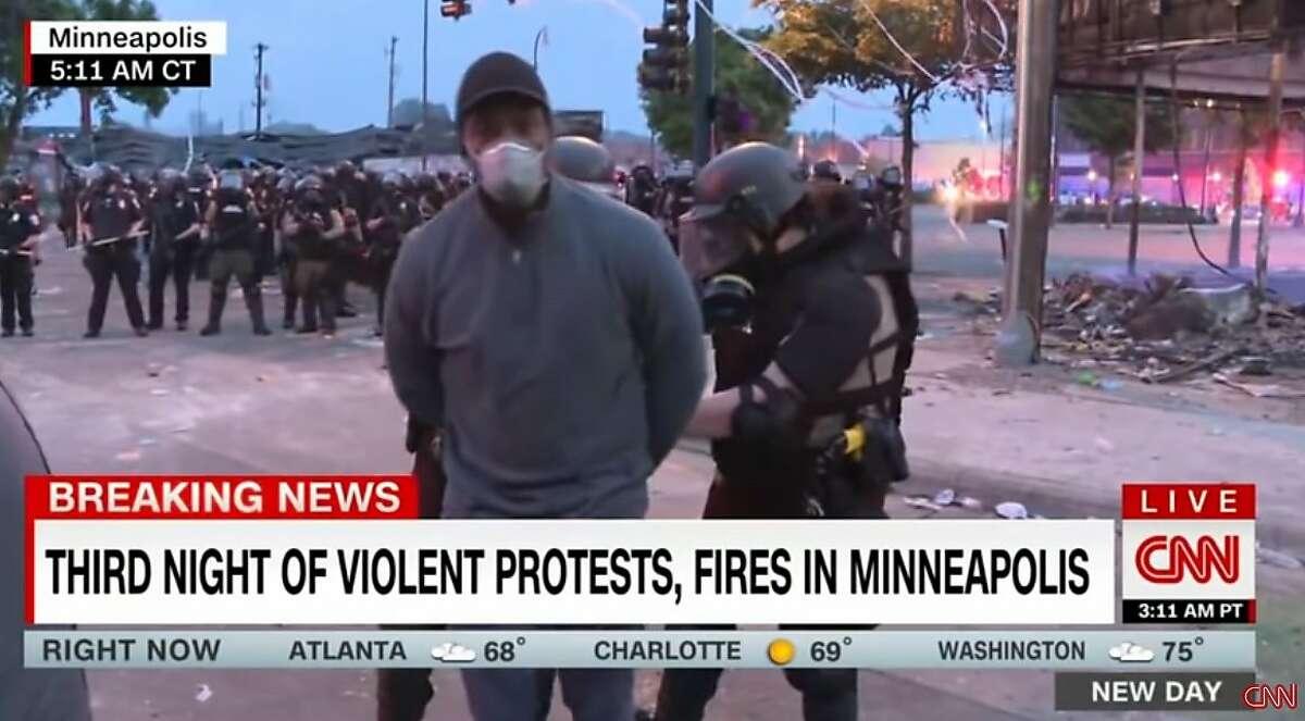 CNN reporter Omar Jimenez being arrested in Minneapolis.