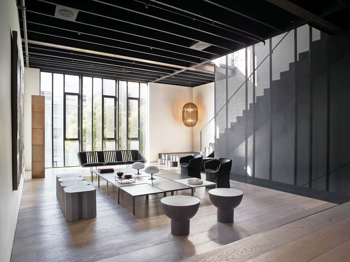 """In the main entertaining space, some of the original steel beams can still be seen, as well as new additions such as the custom perforated-metal staircase. """"Many industrial design cues were taken from the building's original industrial heritage and Western SoManeighborhood,"""" said Nolan."""