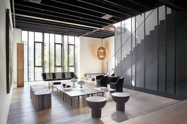 """In the main entertaining space, some of the original steel beams can still be seen, as well as new additions like the the custom perforated metal staircase. """"Many industrial design cues were taken from the building's original industrial hertiage and Western SoManeighborhood,"""" said Nolan."""
