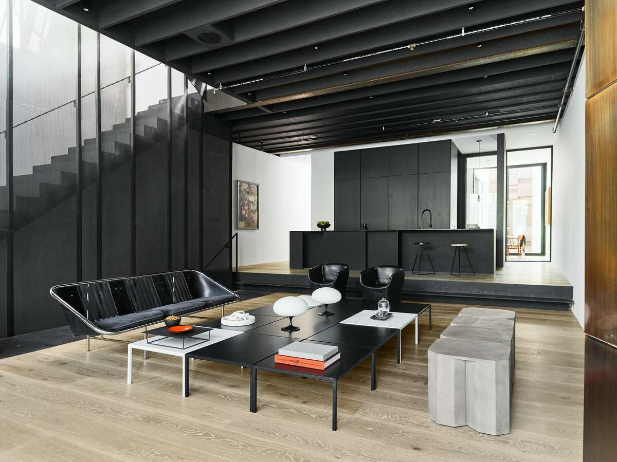 The multipurpose space is utilized as both a living and dining room, and is open to the kitchen. There is also a separate