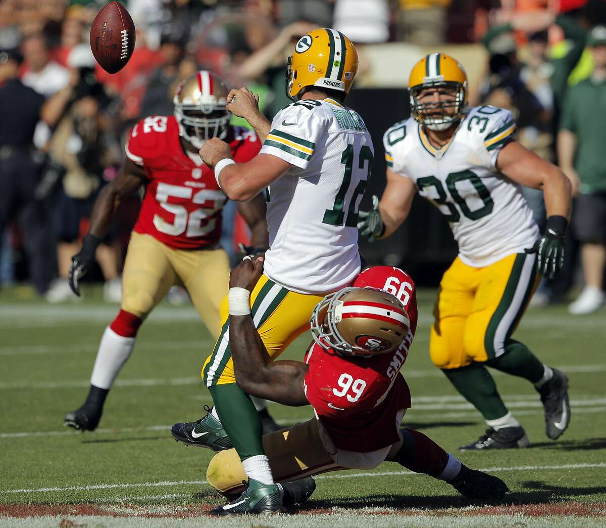 Aldon Smith pressures Aaron Rogers who tries to throw a shuffle pass in the final seconds of the fourth quarter. The San Francisco 49ers played the Green Bay Packers at Candelstick Park in San Francisco, Calif, on Sunday, September 8, 2013.