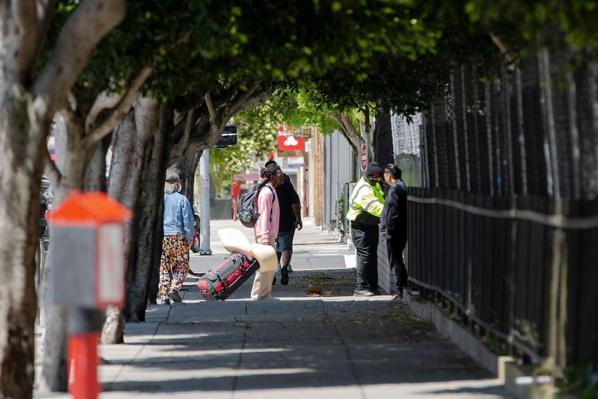An unhoused person waits to enter San Francisco's second Safe Sleeping Village is at the corner of Haight Street and Stanyan Street on Friday, May 29, 2020.