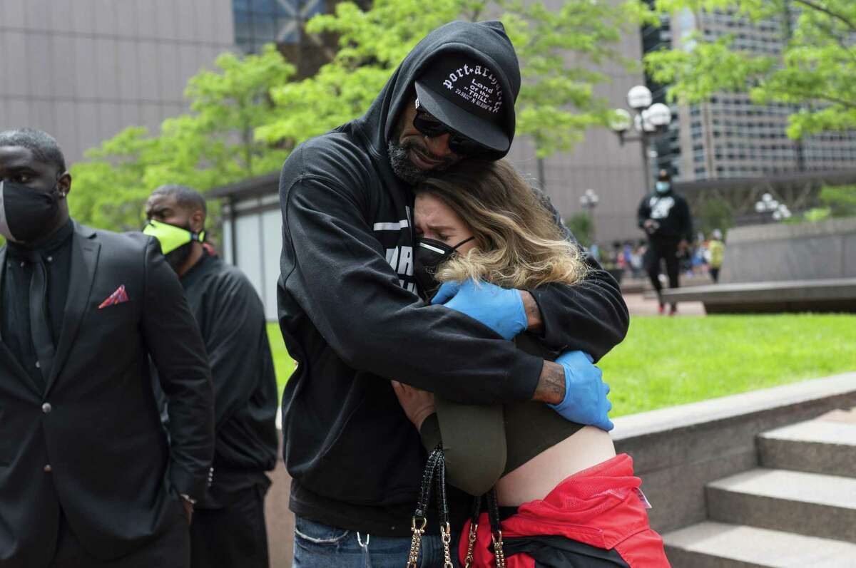 MINNEAPOLIS, MN - MAY 29: Former NBA player Stephen Jackson hugs a woman after speaking at a protest outside the Hennepin County Government Center on May 29, 2020 in Minneapolis, Minnesota. Protests in Minnesota and around the country have been ongoing since George Floyd's death on Monday. (Photo by Stephen Maturen/Getty Images)