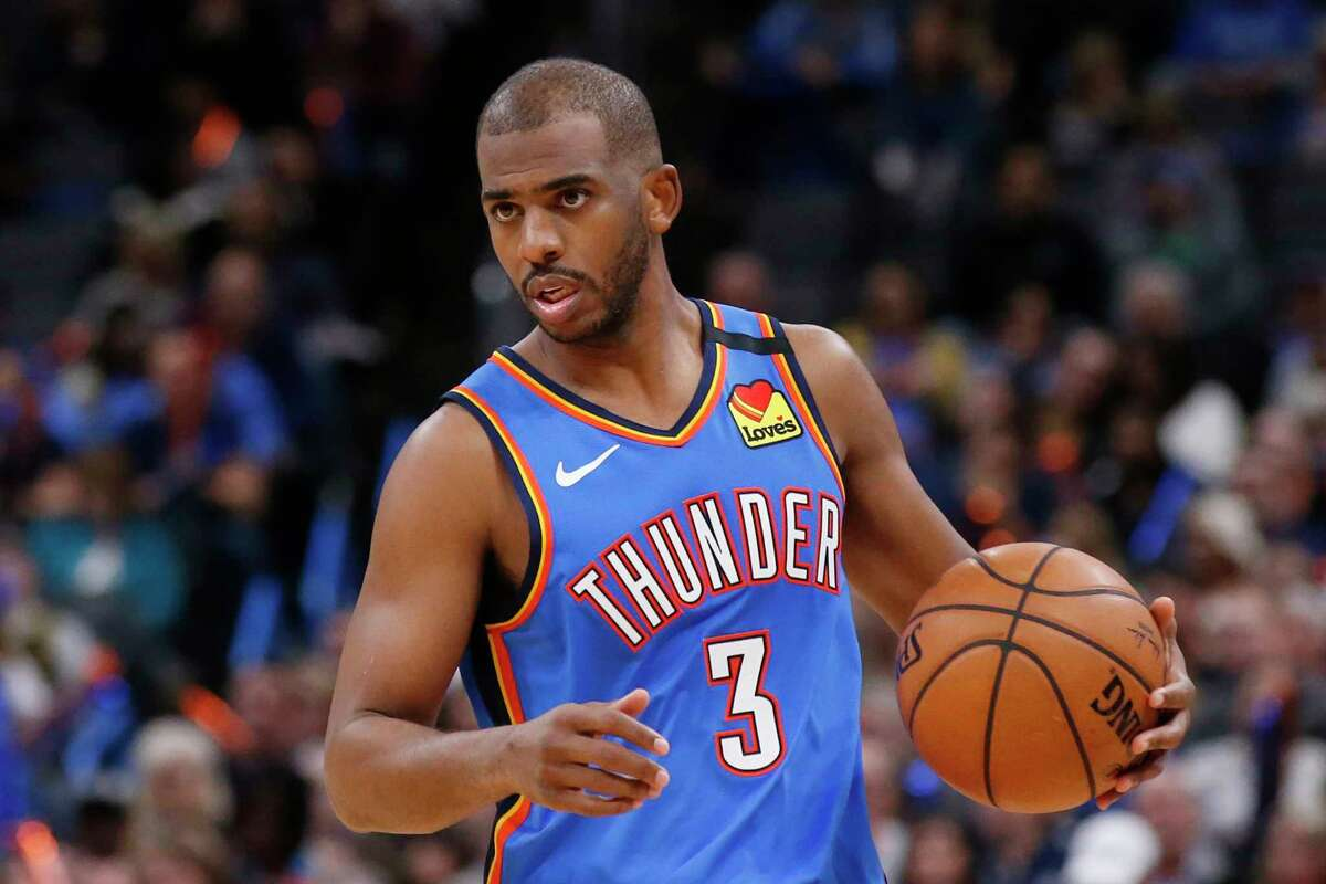 FILE - In this Friday, Feb. 7, 2020, file photo, Oklahoma City Thunder guard Chris Paul (3) is pictured during an NBA basketball game against the Detroit Pistons, in Oklahoma City. The coronavirus pandemic brought sports to a halt, but stay-at-home orders are starting to be eased and a handful of NBA teams are opening practice facilities. (AP Photo/Sue Ogrocki, File)
