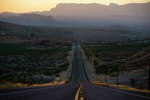 The Chisos Mountains rise in the distance past FM 170 outside of Terlingua early in the morning of May 27, 2020. After a two-month shutdown, Big Bend National Park will reopen beginning Monday for day-use activities including hiking and bicycling, but the Chisos Mountain Lodge will remain closed.