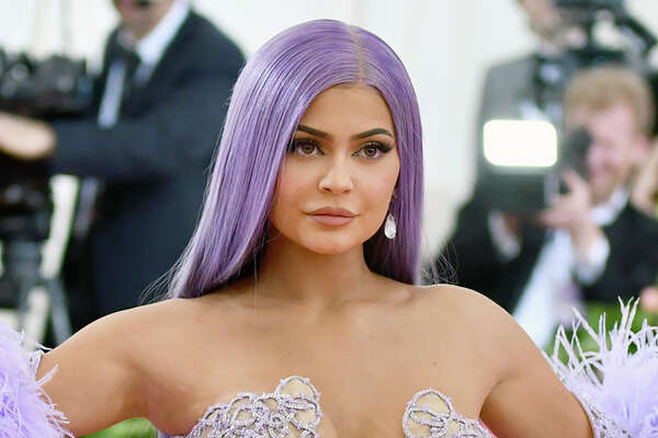 FILE - In this May 6, 2019, file photo, Kylie Jenner attends The Metropolitan Museum of Art's Costume Institute benefit gala in New York. Forbes magazine, which once declared Jenner a billionaire on its cover, says she no longer deserves the title if she ever did, but Jenner is pushing back. Forbes said in a story posted Friday that an examination of financial filings after the reality star and beauty mogul sold 51% of her company Kylie Cosmetics to Coty in a January deal valued at $1.2 billion reveal that Jennera€™s worth was inflated. (Photo by Charles Sykes/Invision/AP, File)