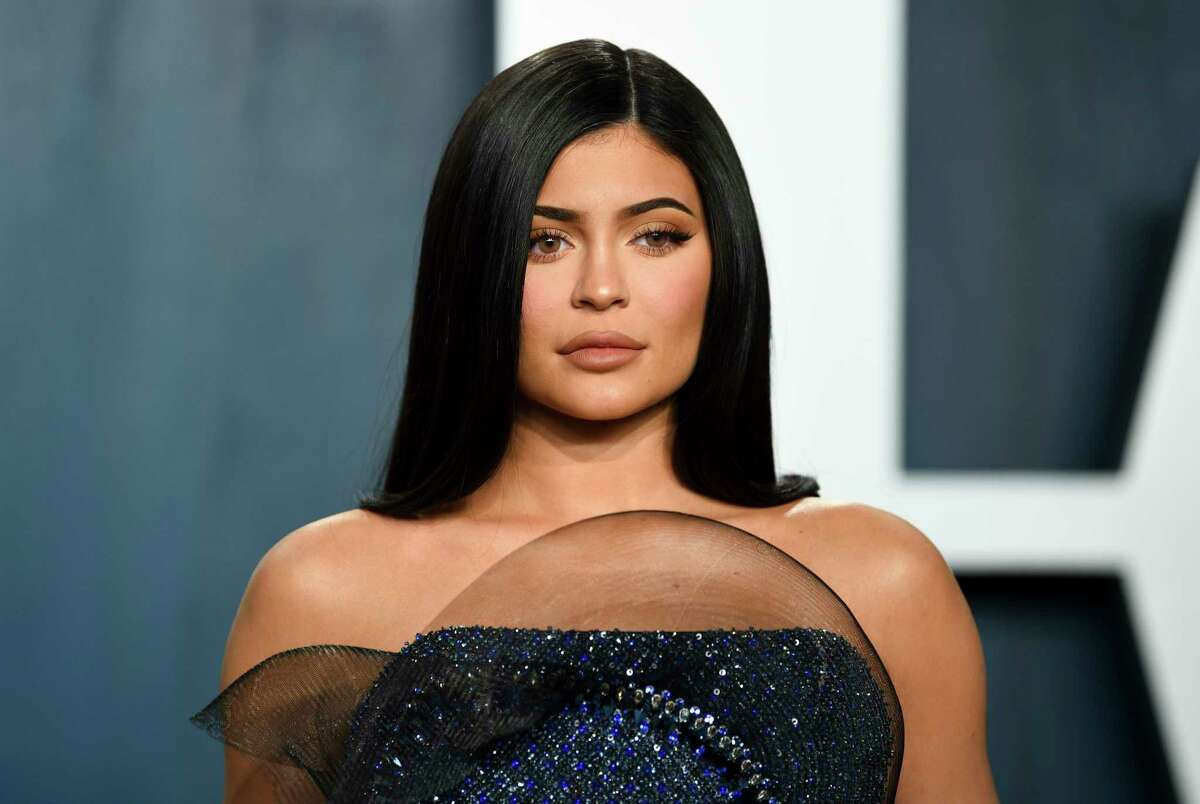 FILE - In this Feb. 9, 2020 file photo, Kylie Jenner arrives at the Vanity Fair Oscar Party in Beverly Hills, Calif. Forbes magazine, which once declared Jenner a billionaire on its cover, says she no longer deserves the title if she ever did, but Jenner is pushing back. Forbes said in a story posted Friday that an examination of financial filings after the reality star and beauty mogul sold 51% of her company Kylie Cosmetics to Coty in a January deal valued at $1.2 billion reveal that Jennera€™s worth was inflated. (Photo by Evan Agostini/Invision/AP, File)