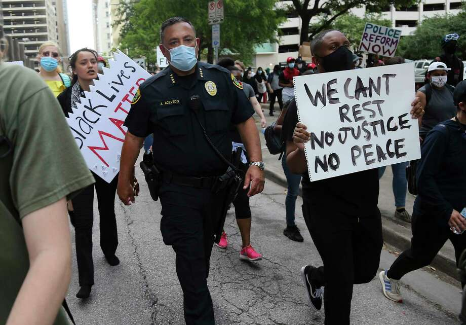 Houston Police Chief Art Acevedo walks with some protesters down Walker Street in downtown Houston on Friday, May 29, 2020. Photo: Elizabeth Conley, Staff Photographer / © 2020 Houston Chronicle