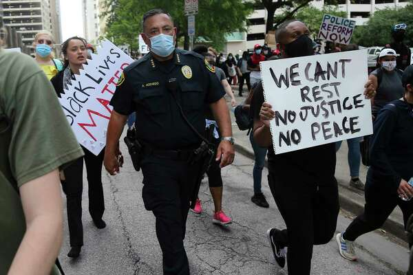 Houston Police Chief Art Acevedo walks with some protesters down Walker Street in downtown Houston on Friday, May 29, 2020.