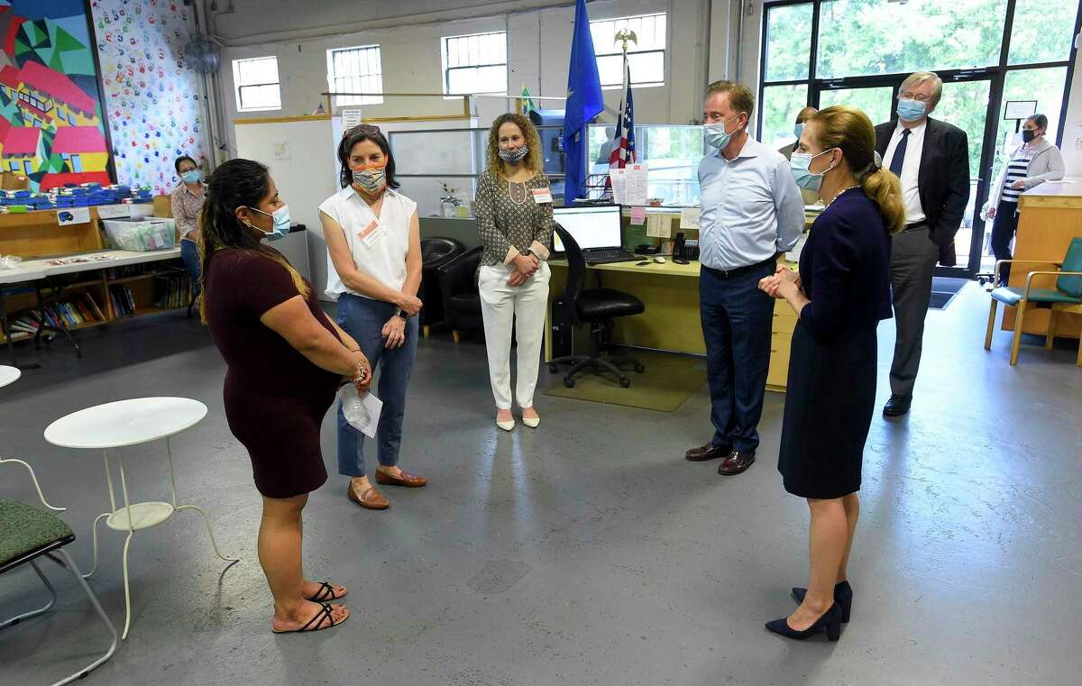 At left, Ruth Sanchez of Stamford meets with Connecticut Governor Ned Lamont and Lt. Governor Susan Bysiewicz, as they visit Building One Community in Stamford, Connecticut on May 29, 2020. The pair had an opportunity to speak with Executive Director Catalina Horak, second from left, and her leadership of the non-profit organization about services being offered to people in the region's immigrant community during the COVID-19 pandemic.