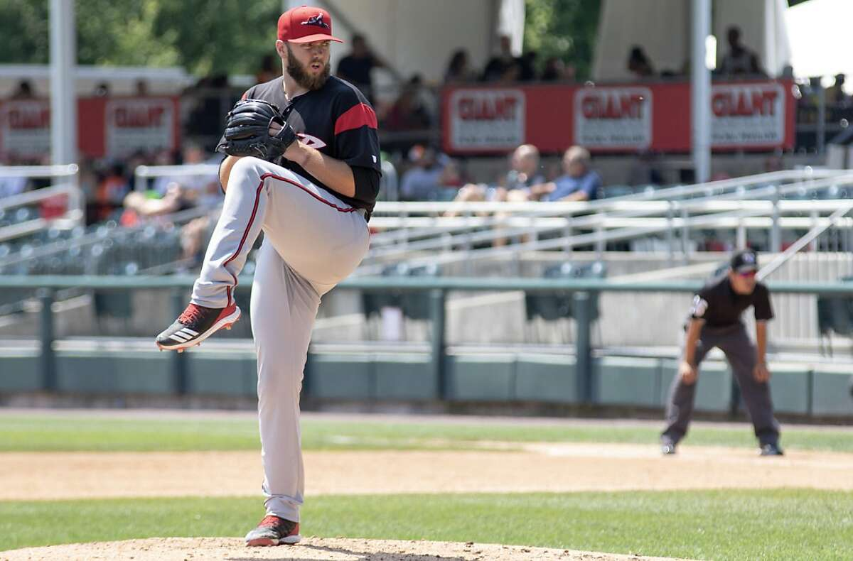 Brandon Lawson, shown pitching for Double-A Richmond, Va., last season, was one of 20 Giants minor-leaguers who were cut Tuesday.