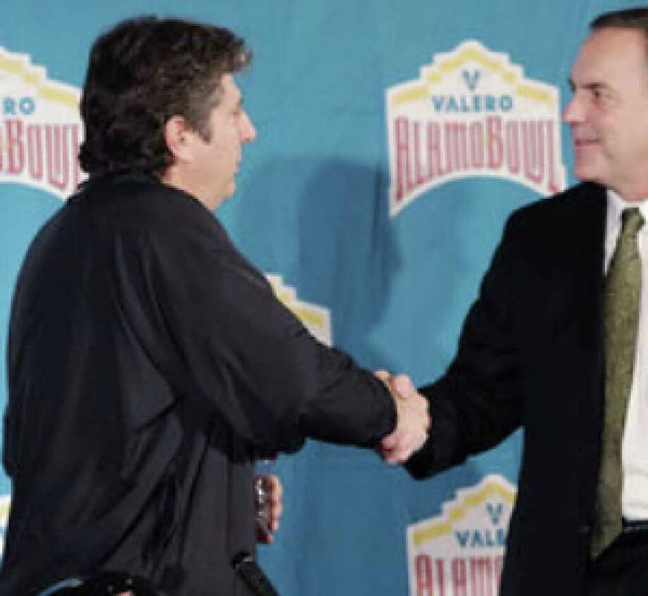 Texas Tech coach Mike Leach (left) greets Michigan State coach Mark Dantonio after both discussed their meeting in the 2010 Alamo Bowl.