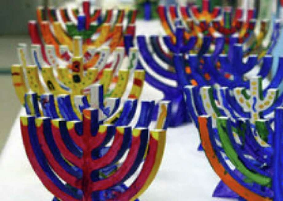 Menorahs painted by students at the Eleanor Kolitz Academy dry in a hallway. The craftsmanship is a way students express their Jewish identity.