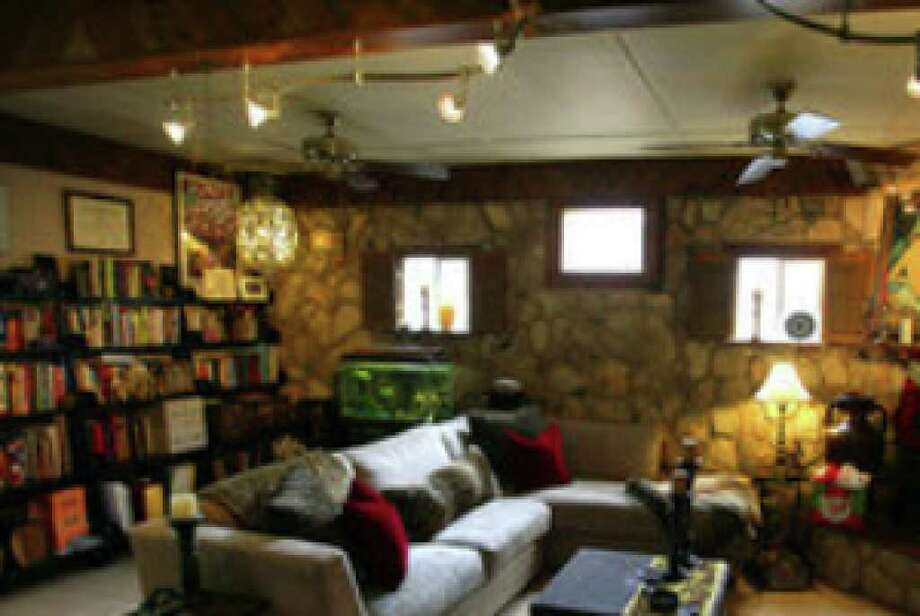 The Peebles' home had a one-car garage that was turned into a den with a fireplace and a rock wall made from native stones by a previous owner.