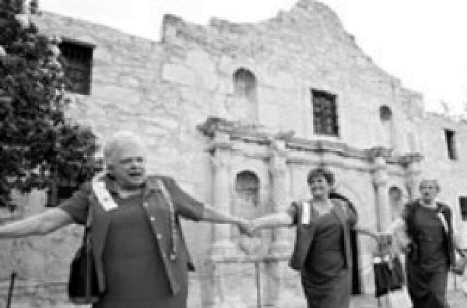 Daughters of the Republic of Texas join hands to encircle the Alamo on Oct. 5, 2006, the 100th anniversary of their custodianship of the shrine.