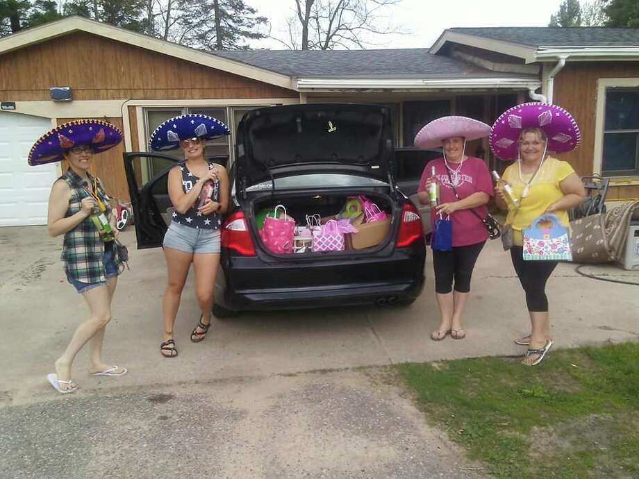 "A group of ""wine fairies"" with the Sisterhood of the Traveling Wine - Mid Michigan prepare to make a delivery. (Photo provided/Facebook)"