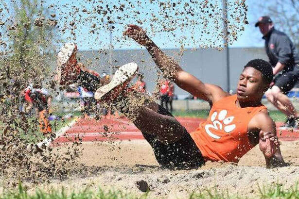 Edwardsville long jumper Kenyon Johnson lands after leaping 22-9 to finish second in the event at the Winston Brown Track and Field Invitational in 2019.