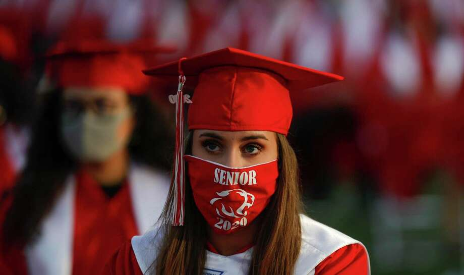 Meagan Londrigan wears a face mask during Crosby High School's graduation ceremony at Cougar Stadium, Friday, May 29, 2020, in Crosby. Photo: Jason Fochtman, Houston Chronicle / Staff Photographer / 2020 © Houston Chronicle