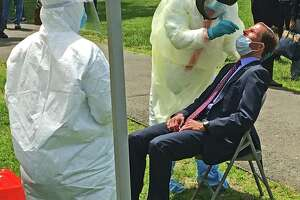 U.S. Sen Richard Blumenthal submits to a nasal swab to test for COVID-19 on the New Haven Green.