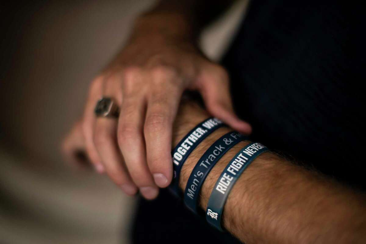 Adolfo Carvalho, 23, who just graduated from Rice University holds bracelets from the time he was a track and cross country athlete for Rice. As Carvalho gets ready to travel to Santiago, Chile in the spring 2021 to work on a research, he will no longer be part of the cross country team. Thursday, May 28, 2020.