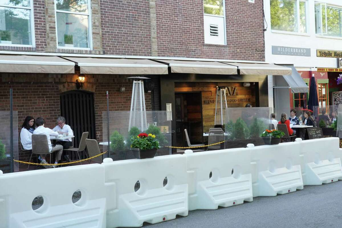 This restaurant in New Canaan is among many that reopened for outdoor dining, with restrictions, after Gov. Ned Lamont gave the go ahead May 20. The barriers were placed to give pedestrians a place to walk and to allow for social distancing.