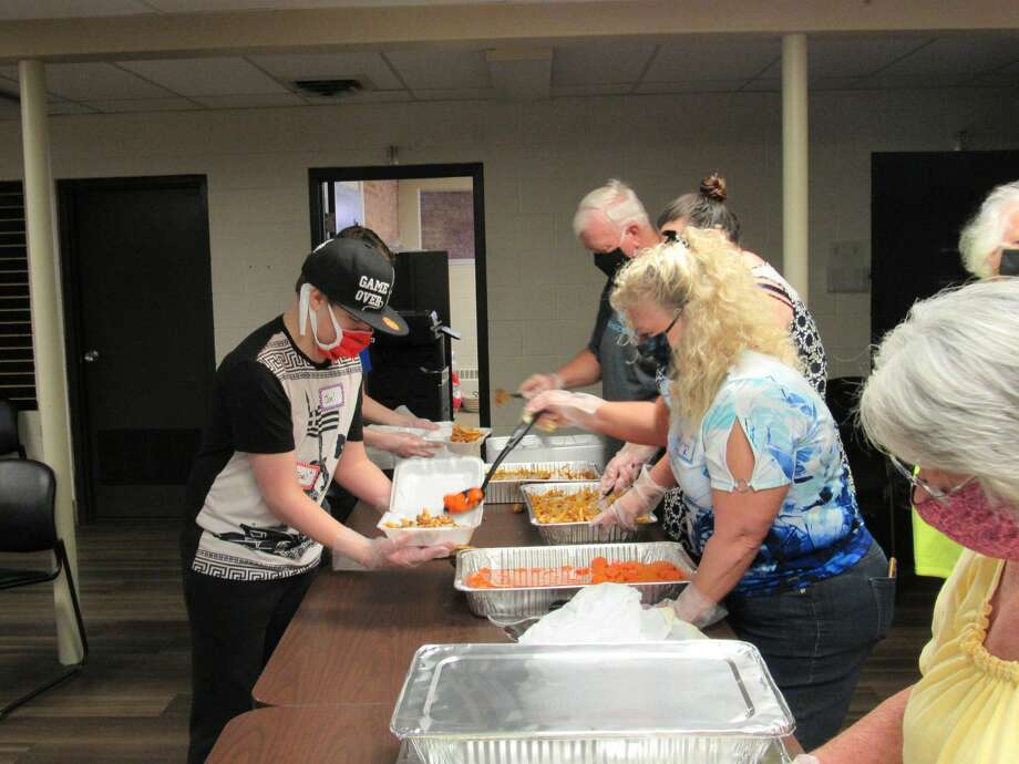 Volunteers assemble homemade meals to distribute on Saturday, May 30 at New Life Vineyard Church in Midland. Photo: Victoria Ritter/vritter@mdn.net