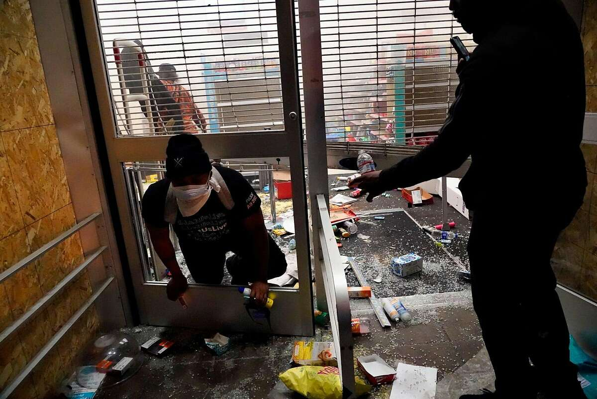 People break into a closed Walgreen�s at 14th and Broadway streets in Oakland, Calif., after protests to the killing of George Floyd by Minnesota police earlier in the week turned violent on Friday, May 29, 2020.