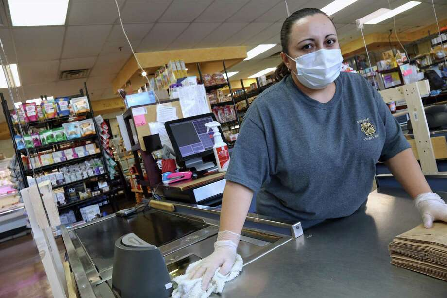 Employee Jenny Pardo takes part in the regular cleaning protocols at The Pantry in Fairfield, Conn. on Wednesday, May 27, 2020. Photo: Jarret Liotta / Jarret Liotta / ©Jarret Liotta 2020