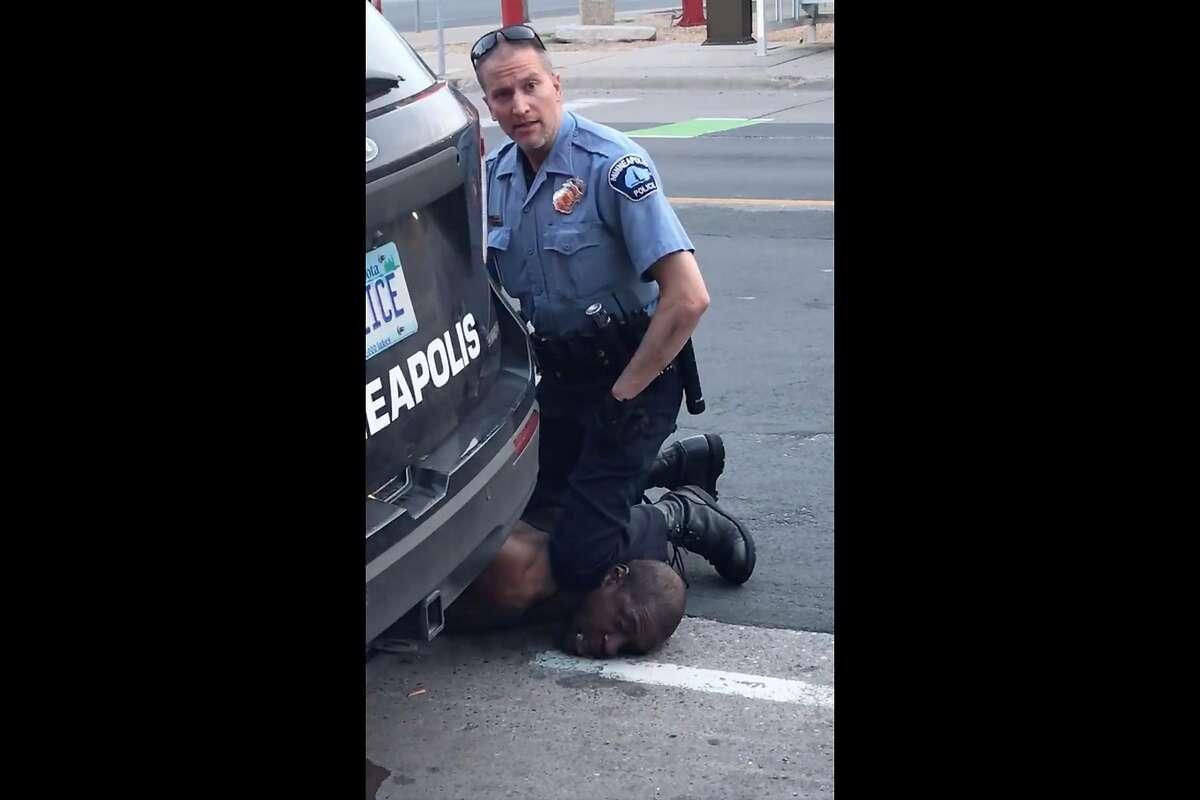 This still image taken from Darnella Frazier's Facebook video shows since-fired Minneapolis police officer Derek Chauvin kneeling on George Floyd's neck.