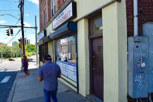 A man walked past 182 West Main St. in Stamford Connecticut on May 30, 2020. Early Friday evening Stamford police were investigating an untimely death in an apartment on the top floor.