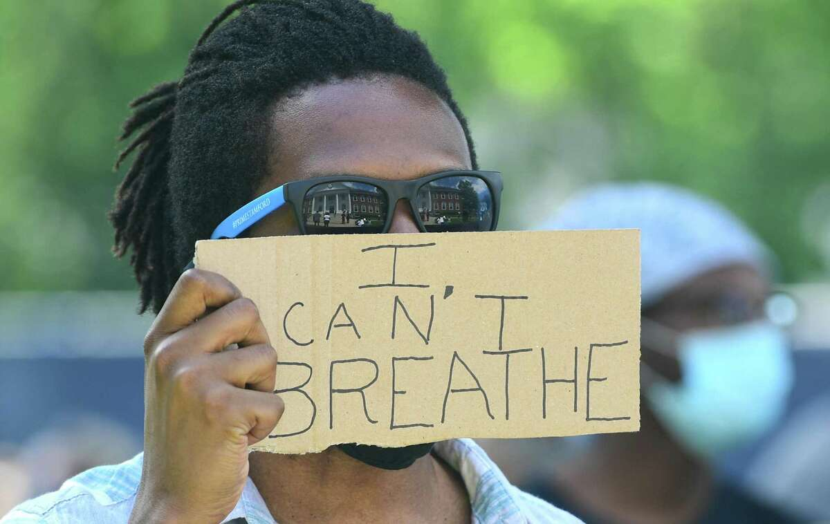 """A photo from the protest in Stratford, Conn., on Saturday, May 30, 2020, showing a protester holding a sign that says """"I can't breathe."""" Protesters gathered across the nation Saturday, expressing outrage over the death of George Floyd in Minneapolis, Minn., on Monday, May 25, 2020."""