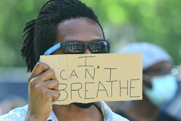 "A photo from the protest in Stratford, Conn., on Saturday, May 30, 2020, showing a protester holding a sign that says ""I can't breathe."" Protesters gathered across the nation Saturday, expressing outrage over the death of George Floyd in Minneapolis, Minn., on Monday, May 25, 2020."
