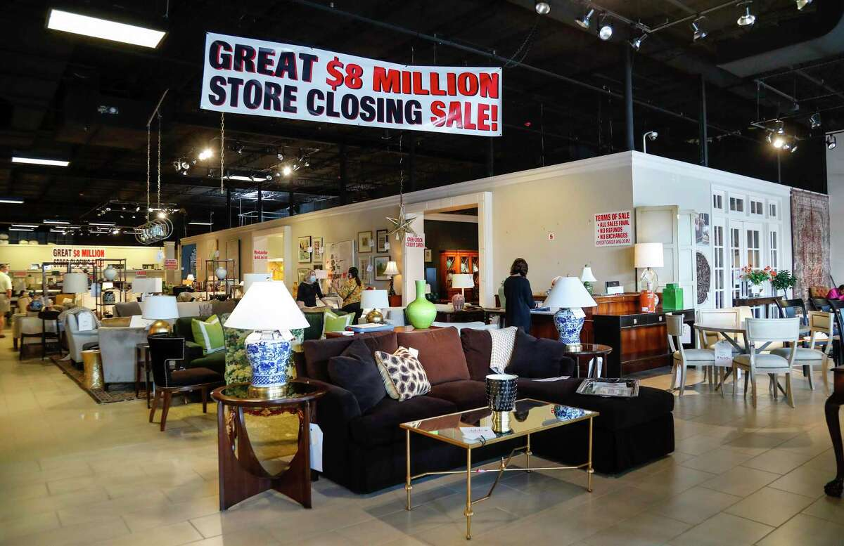 Signs announcing discounts hang in the showroom of Meredith O'Donnell Fine Furniture. Meredith O'Donnell is closing her Post Oak showroom and moving to a more affordable site in the design district on Old Katy Road, in Houston, Thursday, May 28, 2020.