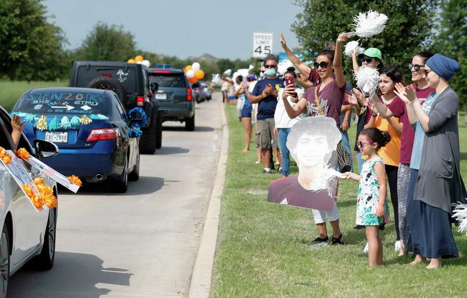 The family of Rayane Aboukinane cheers during a parade for Bridgeland and Cypress Ranch High School, Saturday, in Cypress. Photo: Jason Fochtman, Houston Chronicle / Staff Photographer / 2020 © Houston Chronicle