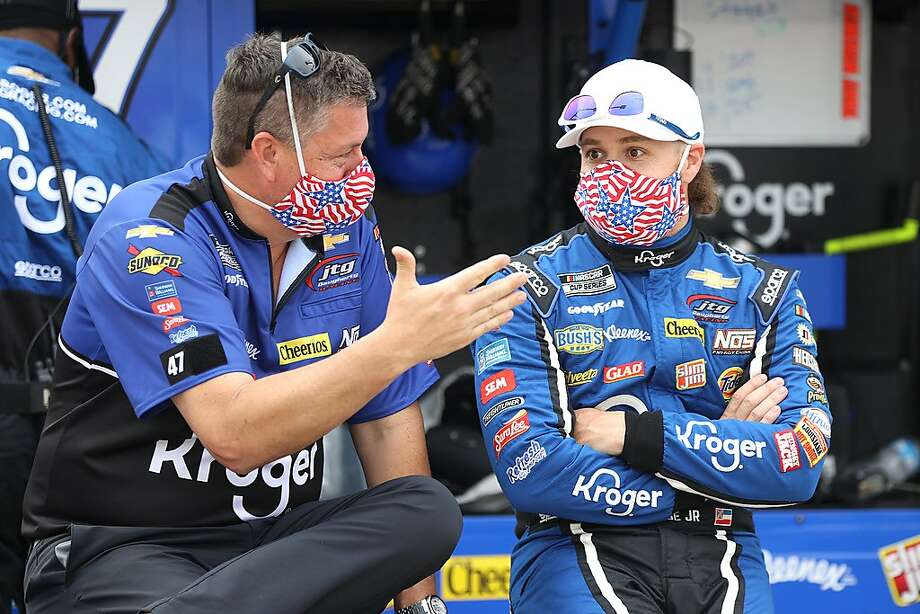 Ricky Stenhouse Jr. (right, with a team member), slipped from 17th to 24th in the Cup Series standings after racing resumed, but climbed back up to 20th at Charlotte on Wednesday. Photo: Chris Graythen / Getty Images