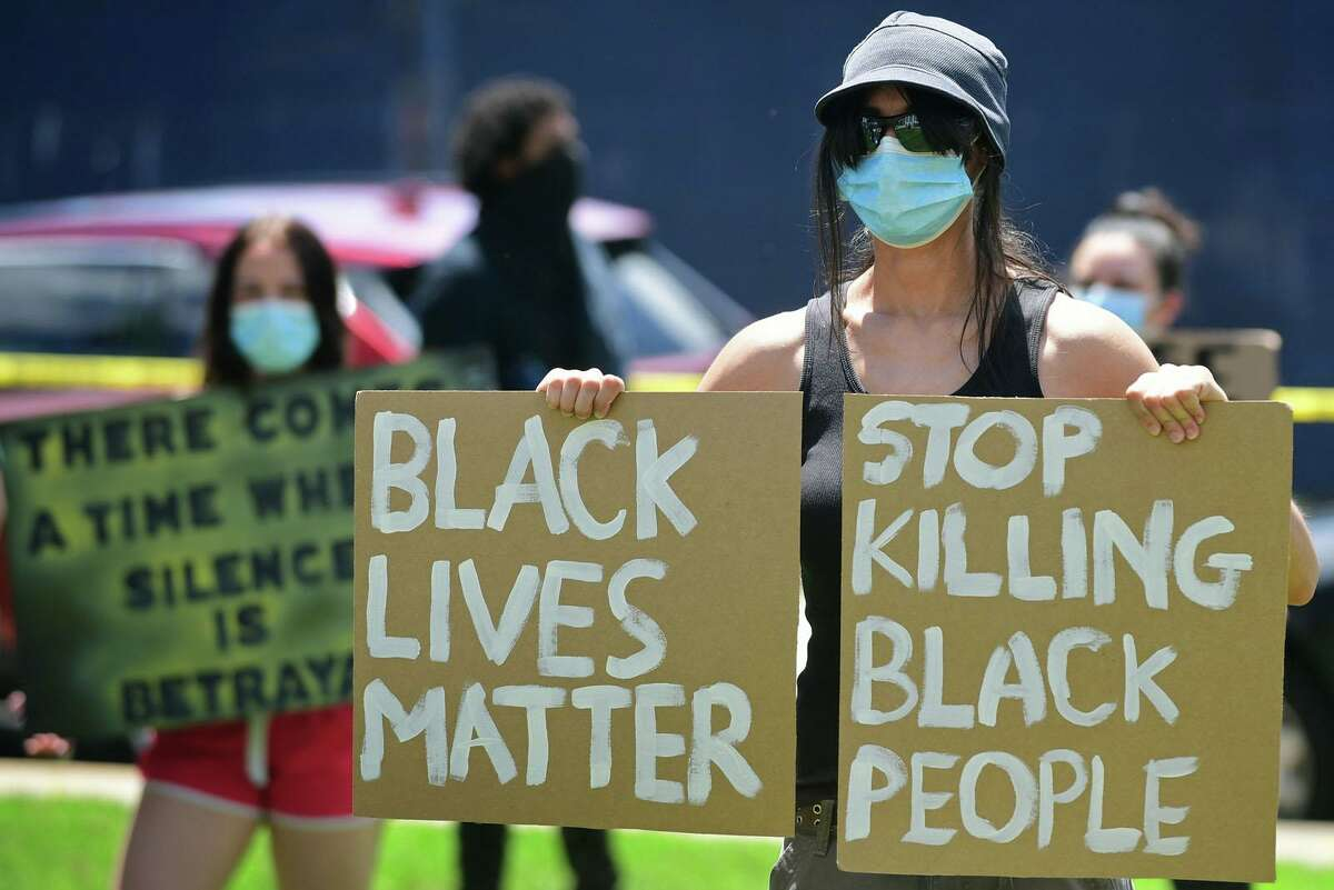 Black Lives Matter | Stop Killing Black People Over 100 protesters gather to protest against police brutality and the death of George Floyd Saturday, May 30, 2020, at city hall in Stratford, Conn.