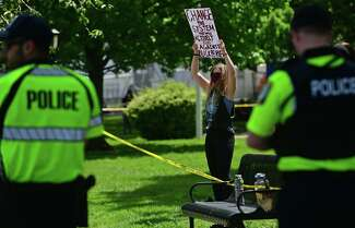 Over 100 protesters gather to protest against police brutality and the death of George Floyd Saturday, May 30, 2020, at city hall in Stratford, Conn.