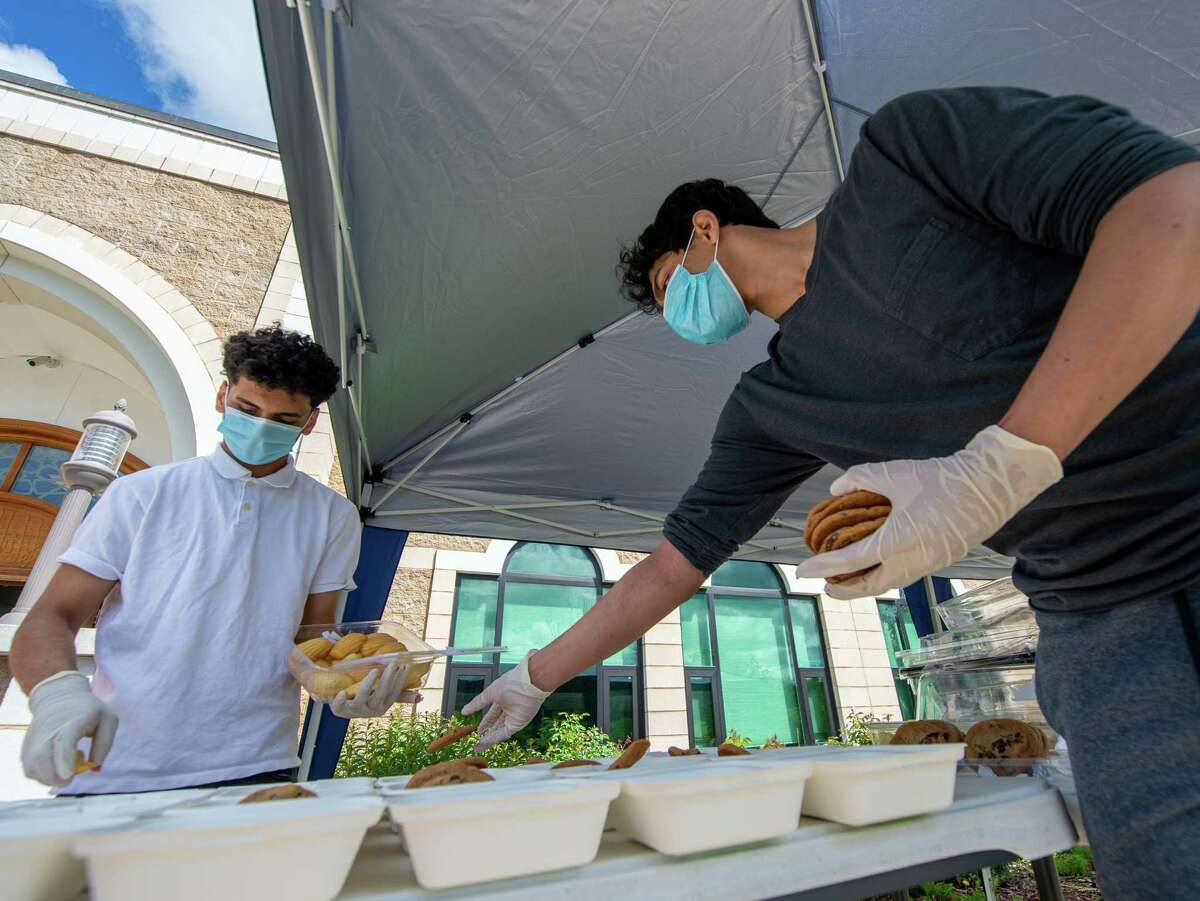 Zaid Shehzad and Mohammed Ahmed prepare food at the Al-Hidaya Center in Latham NY for delivery to community service sites during the Fifth National Muslim Soup Kitchen Day on Saturday, May 30, 2020. (Jim Franco/Special to the Times Union.)