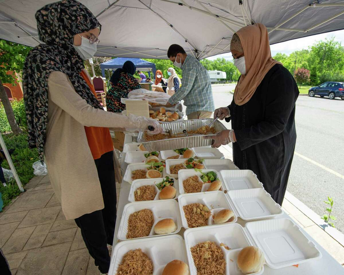 Nada Mohamed and Amira Eltahir prepare food at the Al-Hidaya Center in Latham NY for delivery to community service sites during the Fifth National Muslim Soup Kitchen Day on Saturday, May 30, 2020. (Jim Franco/Special to the Times Union.)
