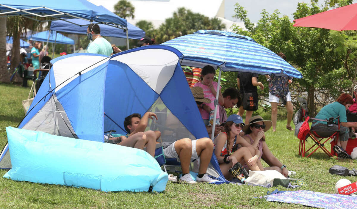 TITUSVILLE, FL - MAY 30: Spectators gather in Marina Park ahead of the launch of a SpaceX Falcon 9 rocket from Cape Canaveral, Florida May 30, 2020 in Titusville, Florida. American astronauts Bob Behknen and Doug Hurley are aboard the Crew Dragon capsule on a mission to link up with International Space Station. This is NASA's first crewed launch from U.S. soil since 2011 at the ending of the Space Shuttle program. (Photo by Red Huber/Getty Images)