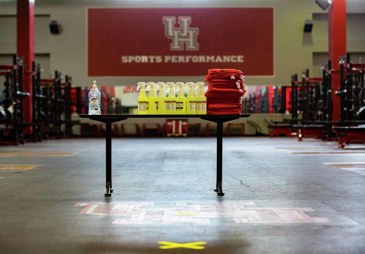 UH student athletes will be received at the weights room and training at the UH Athletic - Alumni Center with disinfectant spray and a piece of clean cloth to wipe anything they touch inside the facility said a member of the staff during a tour of the space on Friday, May 29, 2020, in Houston.