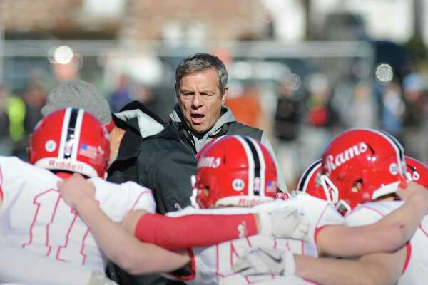 New Canaan football coach Lou Marinelli instructs his team during the 2017 Turkey Bowl game against Darien.
