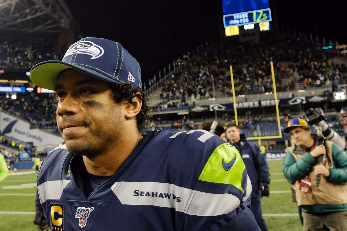Seattle Seahawks quarterback Russell Wilson (3) walks off field after the Seahawks game against San Francisco, Sunday, Dec. 29, 2019 at CenturyLink Field. The Seahawks lost 26-21. (Genna Martin, Seattlepi.com)