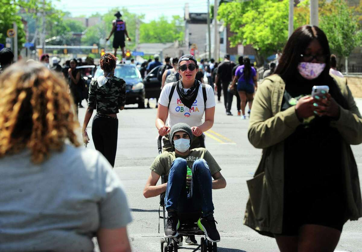 Hundreds of protestors make their way on foot around Bridgeport, Conn., on Saturday May 30, 2020. Over 100 people started protesting at Bridgeport Police headquarters before heading to McLevy Green in downtown Bridgeport and then over to the East Side. The protest was one of dozens all over the country after the death of George Floyd in Minneapolis.