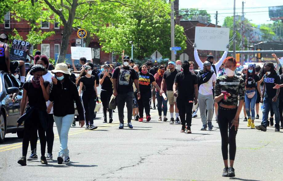 Hundreds of protestors make their way on foot around Bridgeport, Conn., on Saturday May 30, 2020. Over 100 people started protesting at Bridgeport Police headquarters before heading to McLevy Green in downtown Bridgeport and then over to the East Side. The protest was one of dozens all over the country after the death of George Floyd in Minneapolis. Photo: Christian Abraham / Hearst Connecticut Media / Connecticut Post