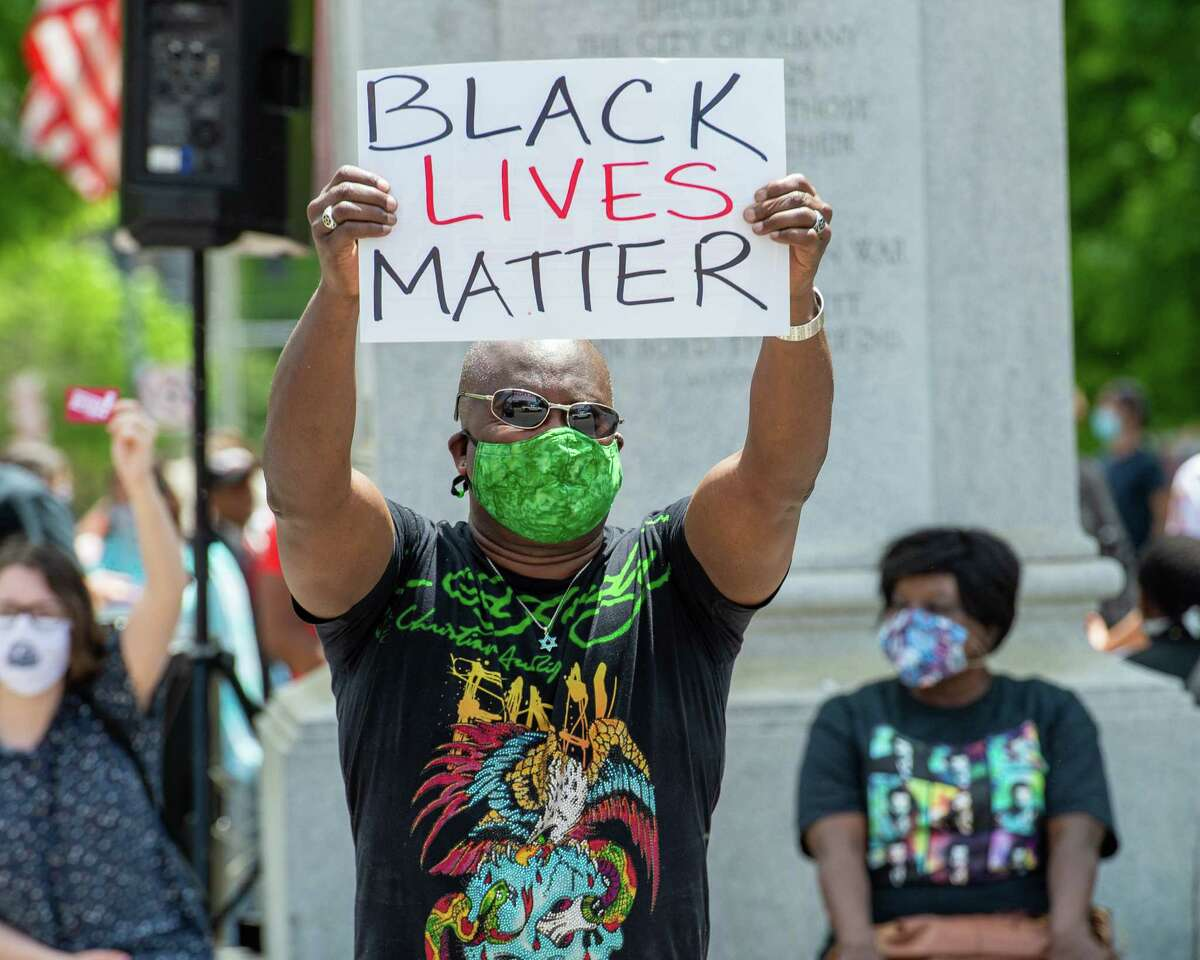 Robin Rabii holds a Black Lives Matter sign during a protest at Townsend Park in Albany, New York on Saturday, May 30, 2020.(Jim Franco/Special to the Times Union.)
