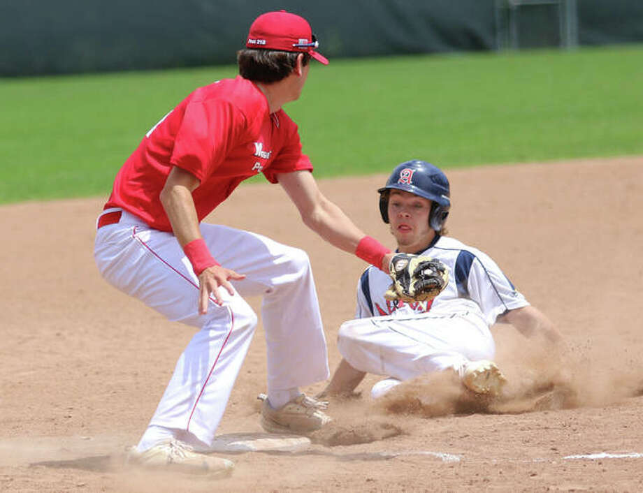 Alton's Trenton Segarra (right) slides into bag and is tagged out stealing by Washington third baseman Brandon Stahlman during Alton's COVID League opener Saturday at Ronsick Field in Washington, Missouri. Photo: Greg Shashack / The Telegraph