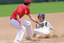 Alton's Trenton Segarra (right) slides into bag and is tagged out stealing by Washington third baseman Brandon Stahlman during Alton's COVID League opener Saturday at Ronsick Field in Washington, Missouri.